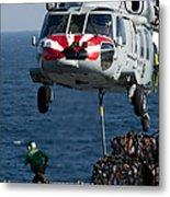 An Mh-60s Sea Hawk Picks Up Pallets Metal Print