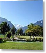 An Open Field In Interlaken With A View Of The Mountains In The Background Metal Print