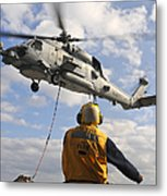 An Sh-60b Sea Hawk Helicopter Releases Metal Print