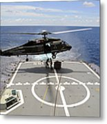 An Sh-60f Sea Hawk Helicopter Lowers Metal Print