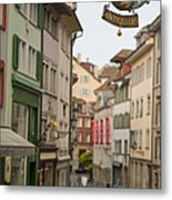 Antique Shop Sign On A Shopping Street Metal Print