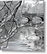 Arch Bridge Over Frozen River In Winter Metal Print