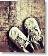Baby Shoes On Wood Metal Print