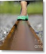 Balance With Her Feet Metal Print