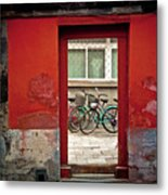 Bicycles In Red Doorway Metal Print