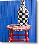 Blach And White Vase On Stool Against Blue Wall Metal Print