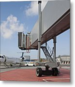 Boarding Bridge Leading To A Parked Plane Metal Print