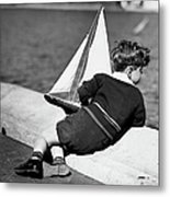Boy Playing With Toy Sailboat Metal Print