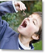 Boy Pretending To Eat An Earthworm Metal Print