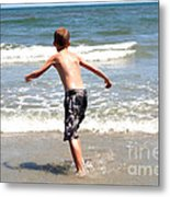 Boy Running Into Surf Metal Print