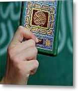 Boy's Hand Holding Koran Metal Print