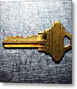 Brass Key On Stainless Steel. Metal Print by Ballyscanlon