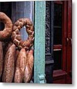 Bread Is Displayed In A Store Window Metal Print