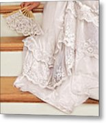 Bride Sitting On Stairs With Lace Fan Metal Print