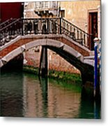 Bridge And Striped Poles Over A Canal In Venice Metal Print