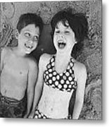 Brother And Sister On Beach Metal Print
