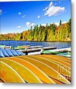 Canoes On Autumn Lake Metal Print by Elena Elisseeva