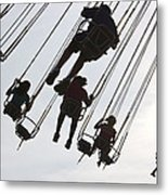 Carnival Goers Enjoy A Ride At An Metal Print