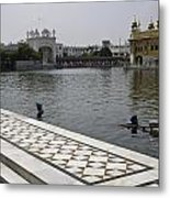 Clearing The Sarovar Inside The Golden Temple Resorvoir Metal Print