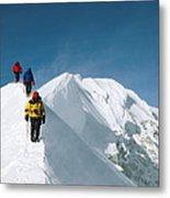 Climbers Hike Along A Ridge Metal Print