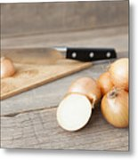 Close Up Of Onions And Knife On Table Metal Print