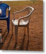Coffee Cups Along With Chairs And Tables In A Quiet Location At Sunset Metal Print