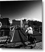 Commuter Cycling Over The Tradeston Bridge Pedestrian Bridge Over The River Clyde To The Financial D Metal Print