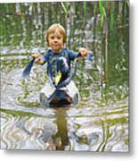 Cute Tiny Boy Riding A Duck Metal Print
