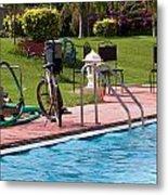 Cycle Near A Swimming Pool And Greenery Metal Print