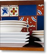 Dishes In Front Of Colorful Tile Metal Print by Thom Gourley/Flatbread Images, LLC