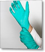 Doctor Putting On Gloves Metal Print