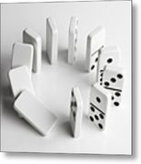 Dominoes In A Circle Beginning To Fall Over In A Chain Reaction Metal Print by Larry Washburn