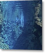 Dry Suit Divers Entering The Gin Clear Metal Print