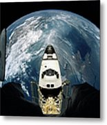 Elevated View Of A Spacecraft Orbiting Over The Earth Metal Print