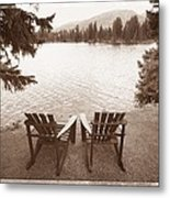 Empty Chairs On Waterfront Metal Print