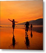 Family Running In The Beach At Sunset Metal Print