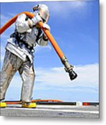 Firefighter Carries A Charged Hose Metal Print