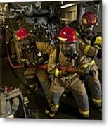 Firemen Combat A Simulated Fire Aboard Metal Print