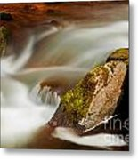 Flowing River Blurred Through Rocks Metal Print