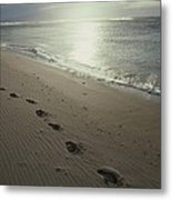 Footprints In The Sand On A Beach Metal Print
