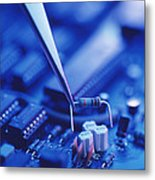 Forceps Holding A Resistor Over A Circuit Board Metal Print