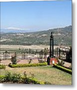 Garden With Some Beautiful Roses Overlooking A Valley With Snow Capped Mountains In The Background Metal Print