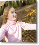 Girl Playing With Autumn Leaves Metal Print