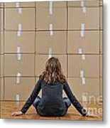 Girl Seated In Front Of Cardboard Boxes Metal Print