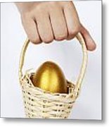 Girl's Hand Holding Basket With Golden Egg Metal Print