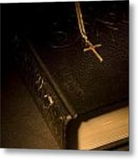 Gold Cross Pendant Resting On A Book Metal Print by Philippe Widling