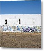 Graffiti On Abandoned Equipment Shed Metal Print by Paul Edmondson