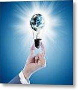 Hand Holding Light Bulb With Globe  Metal Print