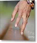 Hand Touching A Railroad Track Metal Print