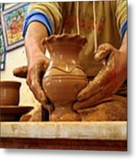 Hands Of The Potter Metal Print